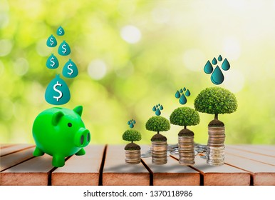Piggy bank green,placed on wooden floor,tree growing on pile of coins and icon,Background bokeh Blur,Financial growth concept Saving, investment planning business,for sustainable