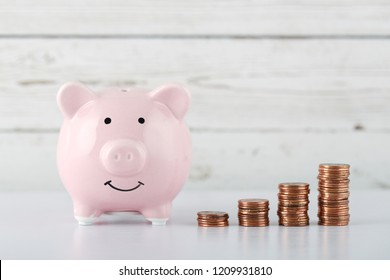 Piggy bank with growth coins which means grwoth business success concept.