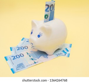Piggy bank isolated on yellow background