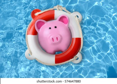 Piggy bank in a lifebuoy concept of financial rescue