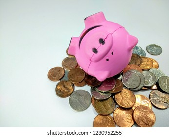 Piggy bank on coins - Don't break the bank