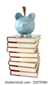 Piggy bank on pile of reference books.  College savings.