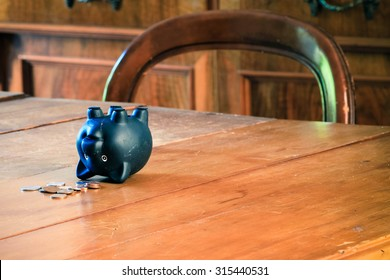 Piggy bank on table.