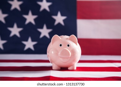 Piggy bank on USA flag background.