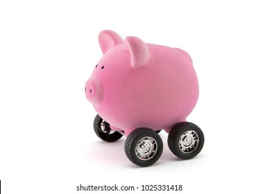 Piggy bank on wheels isolated on white with clipping path