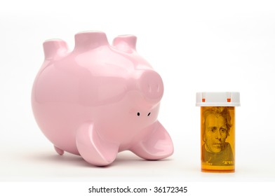 Piggy bank and pill bottle isolated on white background. Conceptual image about the financial challange of healthcare reform in the USA