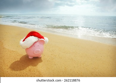 Piggy Bank with Santa hat at beach - Australian Christmas Savings