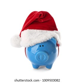 Piggy bank with Santa hat on white background