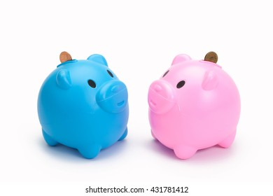 Piggy bank for savings, Inserting a coin into a piggy bank, putting a coin to piggy bank, blue piggy bank.