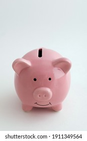 Piggy bank in the shape of a pig on an isolated white background