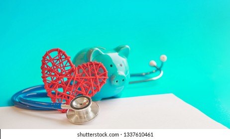 Piggy bank with stethoscope isolated on blue background. tax offset concept. Medical Expense Deductions