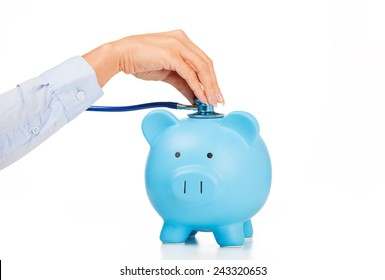 Piggy bank and stethoscope Isolated on white background. Health care cost. Financial state condition self assessment concept. Financial system checkup or saving for medical insurance costs