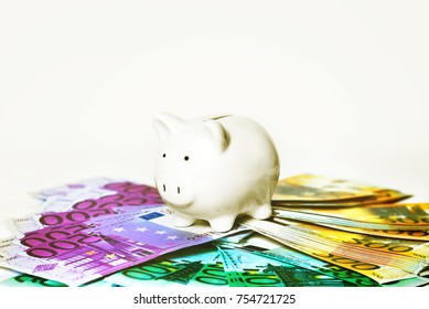 Piggy bank style money box on euros banknote