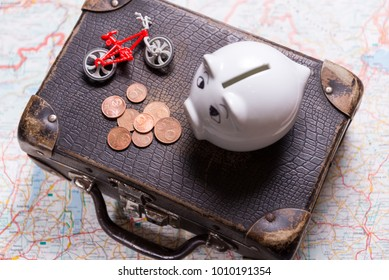 Piggy bank and suitcase, travel planning