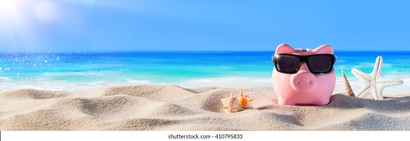 Piggy Bank With Sunglasses On The Beach Holiday