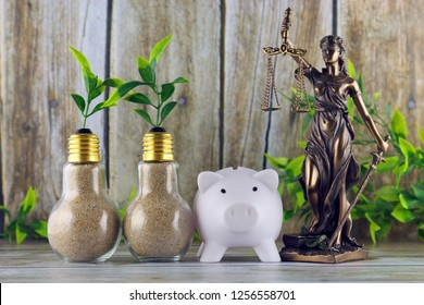 Piggy bank, symbol of law and justice, plants growing inside the light bulbs. Green eco renewable energy concept. Electricity prices, energy saving.
