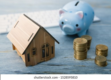 piggy bank; trifle; house; concept of accumulating money to buy