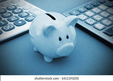 Piggy bank and two calculators, save money concept