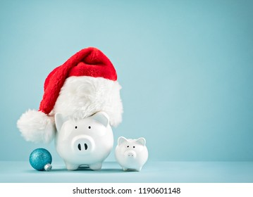 Piggy bank wearing santa hat - Family Saving money for Christmas Concept