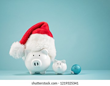 Piggy bank wearing santa hat - Saving money for Christmas Concept