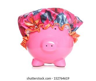 piggy bank wearing shower hat on white background