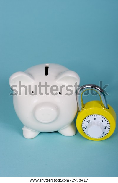 Piggy bank with a yellow combination lock
