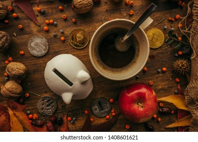Piggy coin bank and cryptocurrency coins on table with autumn season edcoration arrangement, top view flay lay retro toned digital wallet concept