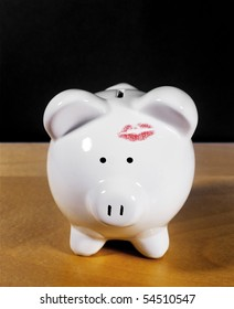 Piggy or coin savings Bank with lipstick kiss
