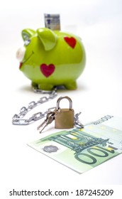 piggy & money banded with  chain and padlock as a concept of security