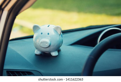 Piggy money box inside a car transportation. Saving money for vehicle purchase. Successful financial planning and banking concept. Economic investment for future. Dealership offering credits.