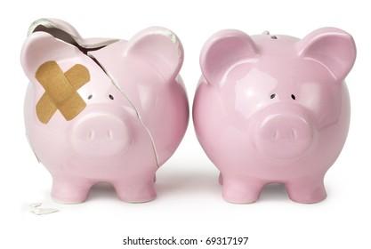 Piggy savings banks, one damaged, one unbroken