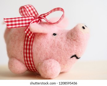 piggy toy with a bow, concept of new year present