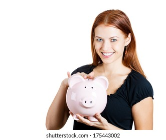 Piggybank money concept. Savings and financial concept. Closeup portrait of young smiling female, woman, excited employee holding piggy bank savings. Human face expression, positive emotions, reaction