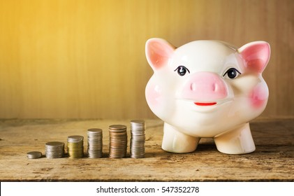 Piggybank and money tower on table.