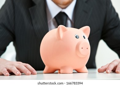 piggy-bank on foreground on a businessman background