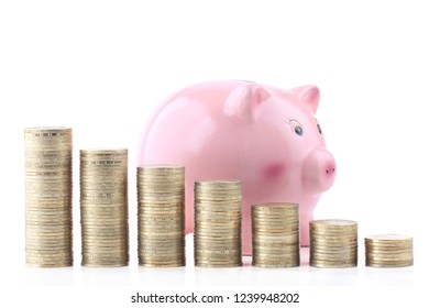 Piggybank and stack of  coins isolated on white background