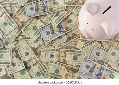 Piggybank surrounded by money resting on a table.