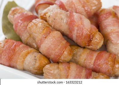 Pigs in Blankets - Sausages wrapped in bacon. Traditional British Christmas dinner side dish.