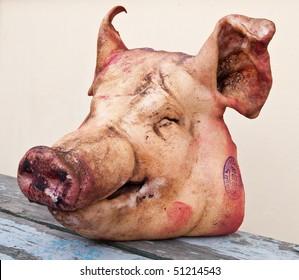 Pig's head chopped off