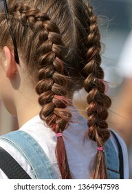 Pigtails from the hair on the girl's head.