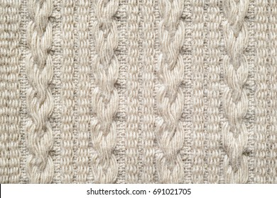 8694f9a9fbd Pigtails on Beige Knitwear Fabric Texture. Machine Knitting Texture Macro  Snapshot. Beige Knitted Background