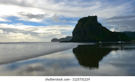 Piha beach, a popular black sand beach for recreational activities in Auckland, New Zealand