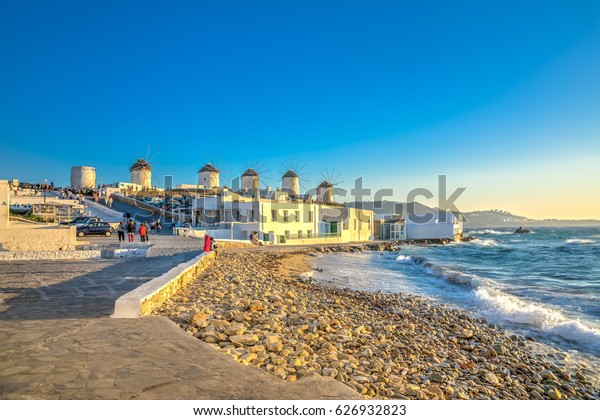 Piictorial view of the windmills from the Little Venice bay of Mykonos town in Mykonos island in Greece