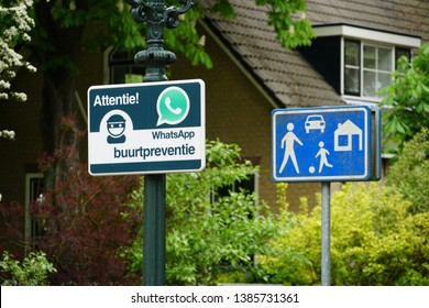 Pijnacker, the Netherlands. May 2019. A sign indicating a neighborhood watch is active in the area, using Whatsapp for communication (Dutch: buurtpreventie).