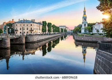 Pikalov bridge at the intersection of Kryukov and Griboyedov canals and the bell tower of St. Nicholas Cathedral in St. Petersburg  in the early sunny summer morning