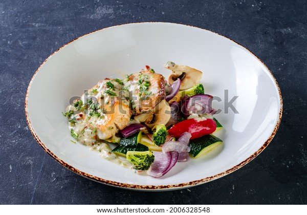 Pike perch fillet in restaurant perch bass with vegetables. Close up. Keto, paleo, fodmap diet food. Healthy concept, gluten free