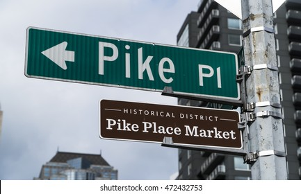 Pike Place Market street sign at  at Pike Place Public Market in Seattle : home to the original Starbucks coffee shop.