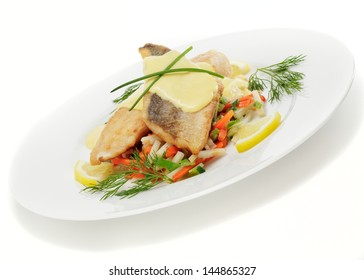 Pike-perch fillet with hollandaise sauce on vegetable strips