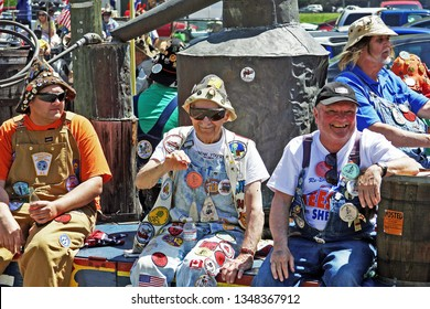 Pikeville, Kentucky - April 15, 2014: Men dressed in overalls and riding in the annual Hillbilly Days parade