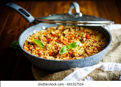 Pilaf with beef, carrots, onions, garlic, pepper and cumin. A traditional dish of Asian cuisine.